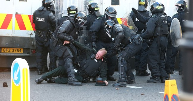 10 Belfast police hurt in riot over blocked Protestant march