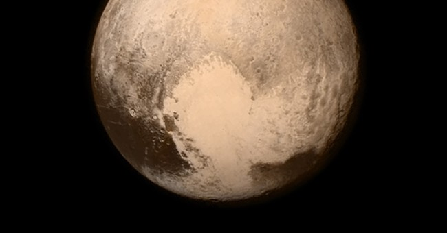 Pluto up close: Spacecraft achieves flyby, then calls home