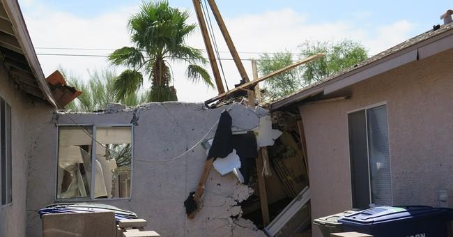 Stolen tractor crashes into 2 Arizona homes, starts fires
