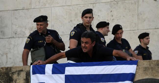 The Latest: Greece needs 85 billion euros through 2018