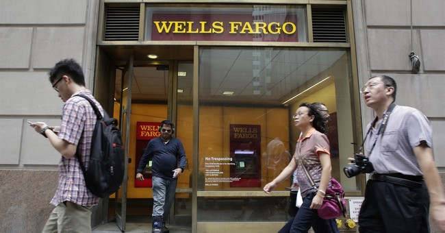 Wells Fargo profit edges lower in 2nd quarter