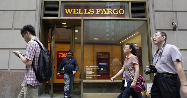 Wells Fargo profit edges lower in 2nd quarter