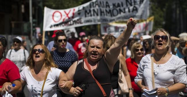 Greek lawmakers pass austerity bill despite dissent
