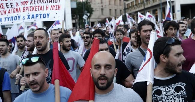 The Latest: Greek Parliament passes austerity bill