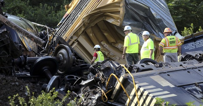 Locomotive rear-ends train; 18 cars derail, lube oil spills