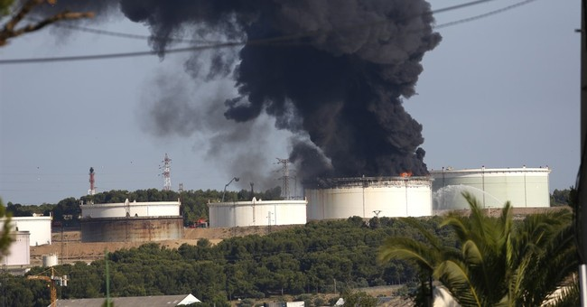 French minister says double plant blast was criminal act