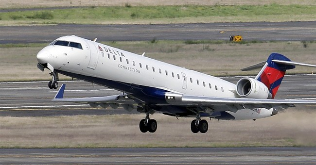 Delta soars on cheap fuel, but hints of a decline in fares