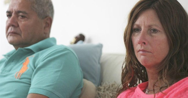 A year later, MH17 relatives grieve, wait for answers