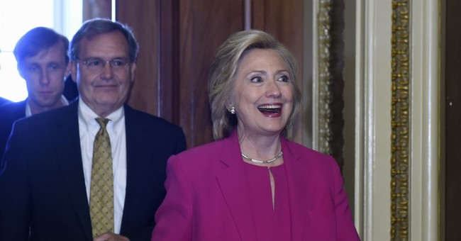 Hillary Clinton spends $18 million, hires hundreds