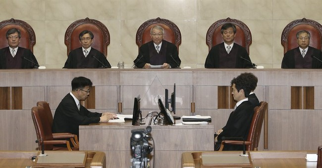 S. Korean court orders new trial for convicted ex-spy chief