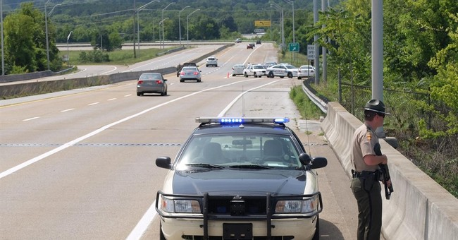 The Latest: FBI says shooter initially fired from inside car