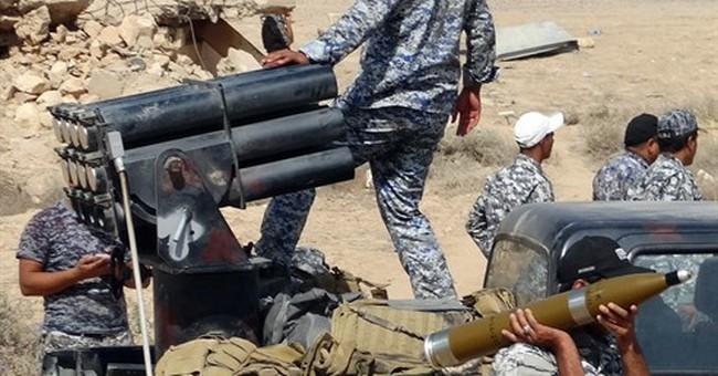 Kurdish fighters besiege IS gunmen in Syria's Hassakeh city