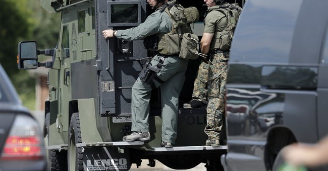 4 Marines and gunman die in attack on 2 military sites