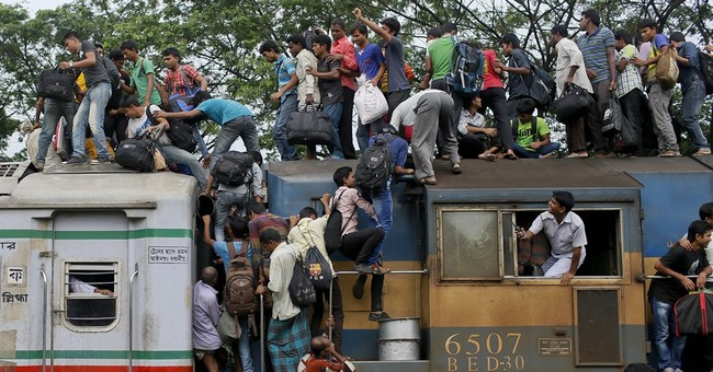 Image of Asia: Taking the train home before Eid al-Fitr