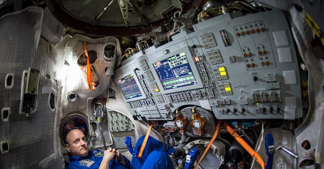 Space station astronauts take shelter from space junk