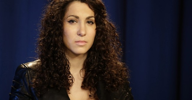 Woman in street harassment video sues director, organization