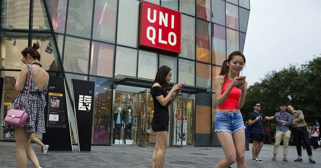 China reprimands online companies for spread of sex video