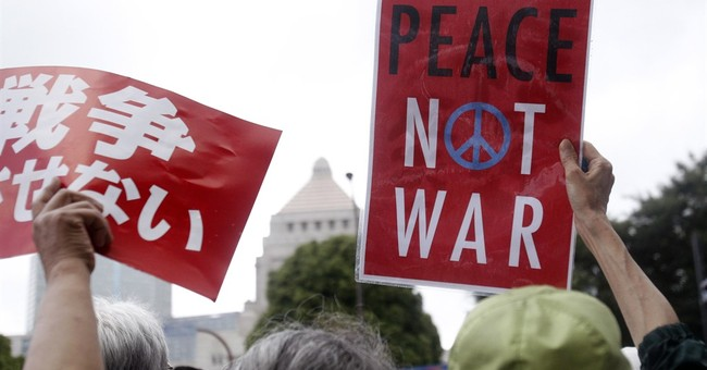 Japan's lower house of parliament OKs expanded military role