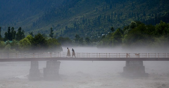 Image of Asia: Watching the water after rains in Kashmir
