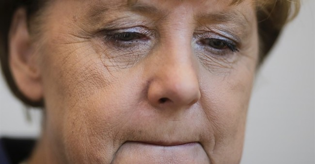 Refugee encounter highlights Merkel's complicated image