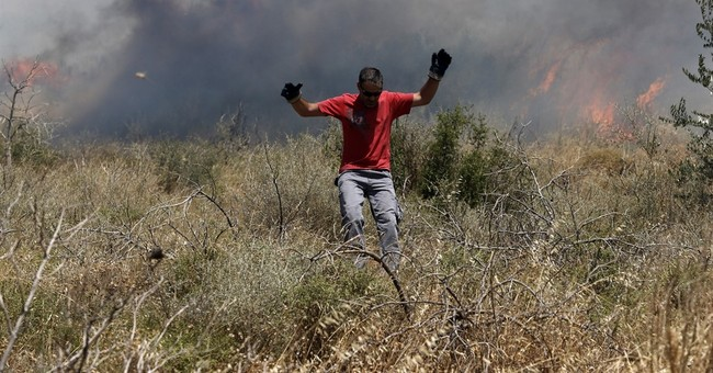 Greek firefighters battle blazes; save 200 trapped on beach