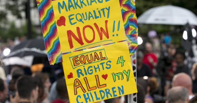 AP Poll: Sharp divisions after high court backs gay marriage