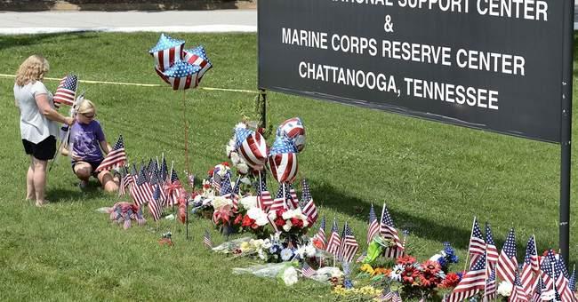 The Latest: Mom of slain Marine visits high school memorial