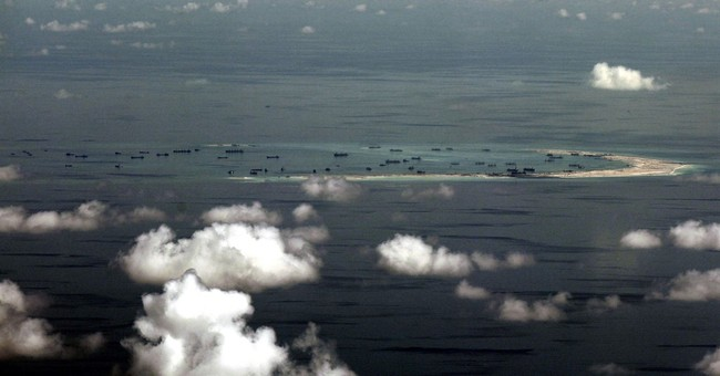 Taiwan promotes its island claim in South China Sea