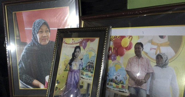 Scene of AirAsia victim's burial reveals family's deep loss