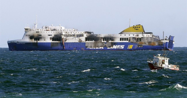 Firefighters find black box on still-burning ferry