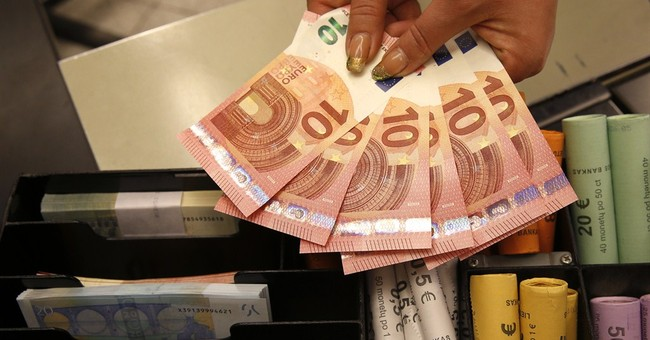 Euro sinks after ECB chief gives stimulus hint