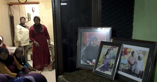 Scene of AirAsia victim's burial reveals family's deep loss