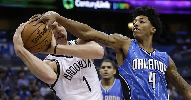 Nets hold off late rally by Magic in 100-98 win