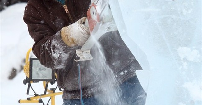 Workers craft ice playground ahead of Alaska sculpture event