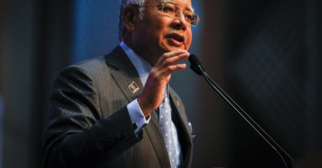 Malaysia slashes 2015 budget, cuts growth forecast