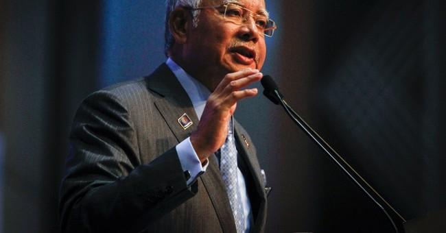 Malaysia slashes 2015 budget, cuts growth forecast