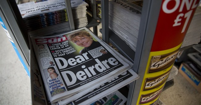 Feminists cheer as bare breasts disappear from UK tabloid