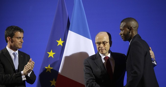 Man who saved lives at Paris grocery gets French citizenship