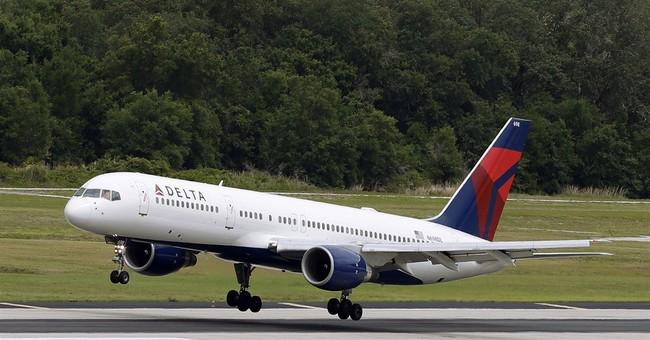 Delta posts 4Q loss after writing down fuel-hedging deals
