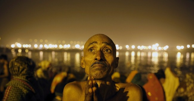 Image of Asia: Hindus pray to wash away sins in rivers