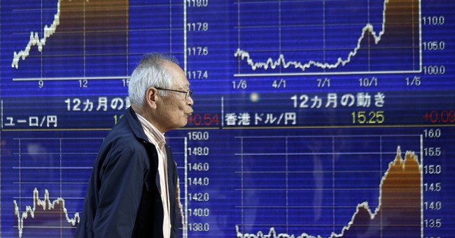 Most Asian stocks higher as investors await ECB decision