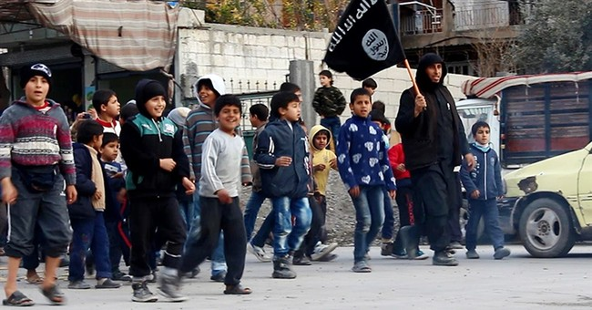 In an IS training camp, children told: Behead the doll