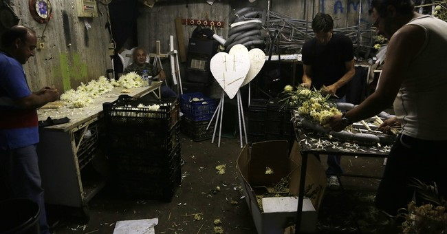 IOUs for RIPs: Greece's cash crisis hurts funeral industry