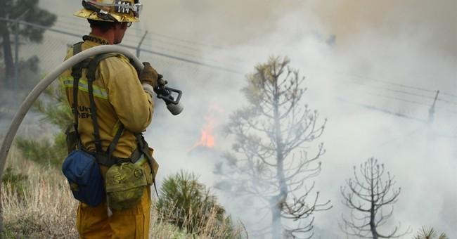 Rain calms California fire that jumped freeway, burned cars