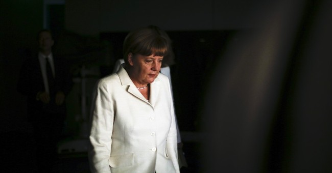 Merkel defends frank talk that brought girl to tears