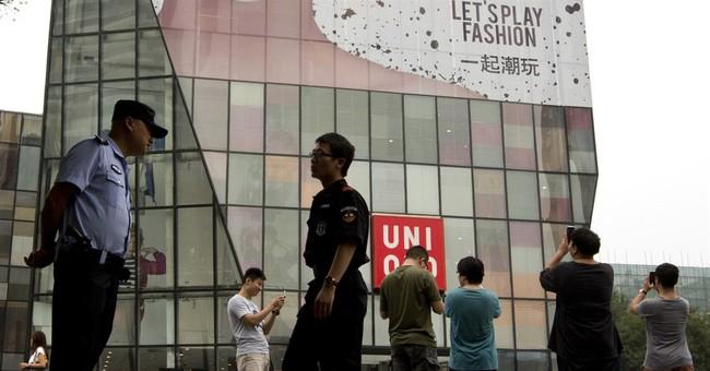 Beijing police detain 4 for sex video that spread online