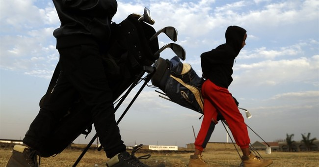 AP PHOTOS: Retired South African caddy teaches golf to kids