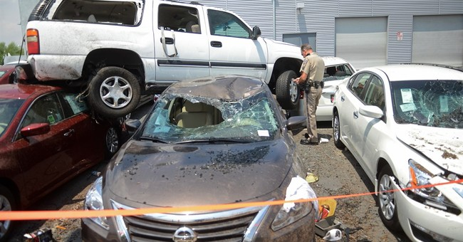 Child hurt when SUV rolls off highway, into dealership lot