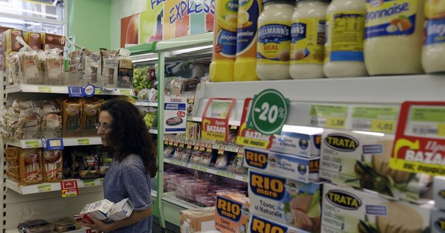 Taxes and more taxes: Greeks grapple with new price hikes