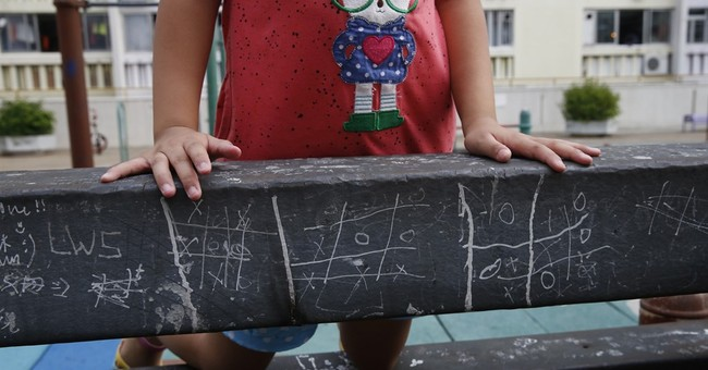 AP PHOTOS: In digital world, the allure of simple games